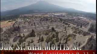 Aerial video of Boles Fire burned neighborhood in Weed California.