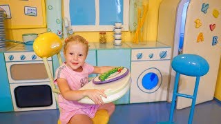 Nastya plays at the funny playhouse of Peppa toy Theme Park