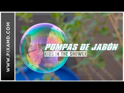 PRETEEN BLOWING BUBBLES OF SOAP IN THE SHOWER