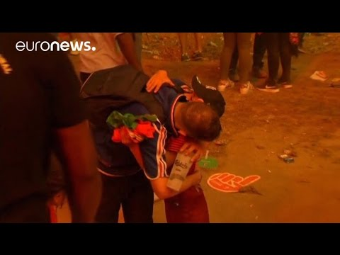 Euro 2016: Young Portugal supporter consoles teary-eyed French fan