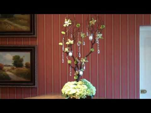 Table centerpieces and a manzanita branch creation in lime green flowers for