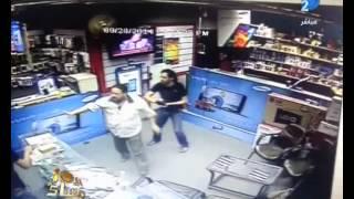 برنامج العاشرة مساء شاهد .. فى عز الضهر محل موبايل بيتسرق تحت تهديد السلاح فى عين شمس