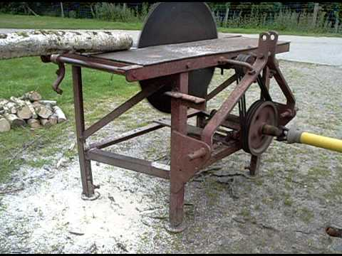 Tractor PTO driven circular saw bench being driven by Grey ...