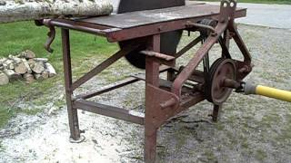 Tractor PTO driven circular saw bench being driven by Grey Fergie