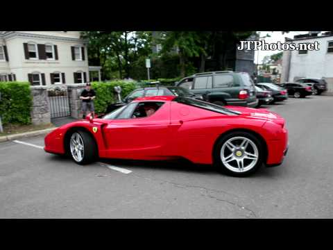 Tommy Hilfiger driving his Ferrari Enzo