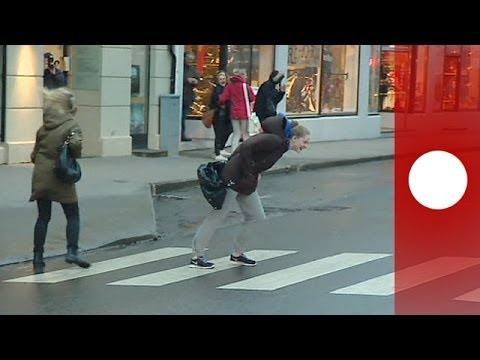 People trying to walk against the wind in Norway
