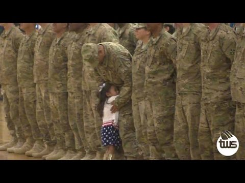 Daughter Hugs Daddy During Fort Carson Welcome Home Ceremony