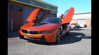 BMW i8 full vinyl wrap in gloss orange