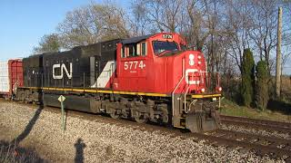 CN 5774 rolls West with lumber loaded flat cars in a local freight train near Vicksburg, MI