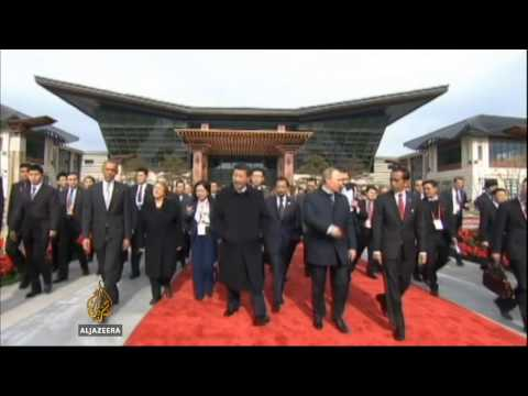 China displays global clout at APEC summit