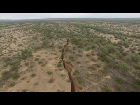 2-Mile-Long Mysterious Crack Found in Arizona Desert. Nestle drained all the water in area.