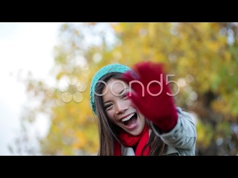 Fall woman waving hello and blowing a kiss. Stock Footage