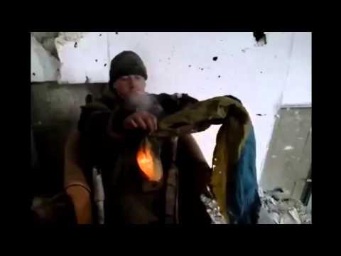 Ukraine War   Rebel burning Ukrainian flag  Donetsk Airport