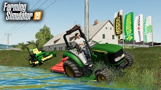 FS19- CUTTING GRASS AT THE DEALERSHIP! (LAWN TRACTOR ALMOST SLIPS INTO POND)