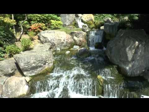THE KYOTO GARDEN WATERFALL IN HOLLAND PARK, LONDON - JULY 11, 2013