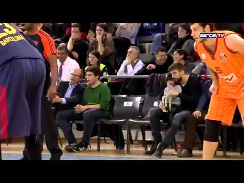 Gerard Piqué and his son Milan watching the FC Barcelona basketball team