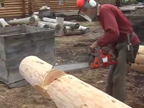 Corner notch cutting and brushing for log cabin for Cheap home building techniques