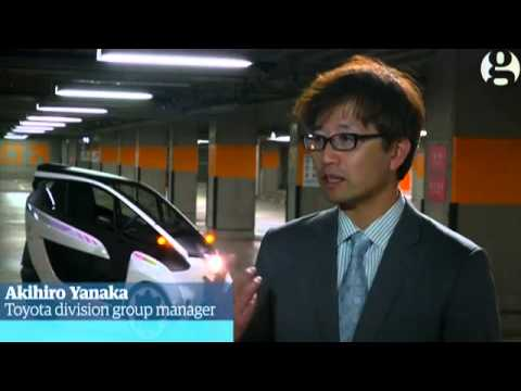 Toyota's electric three-wheeled car takes the i-Road to combat Tokyo's pollution – video