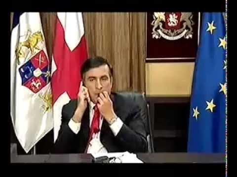Georgian President Mikheil Saakashvili eats his tie
