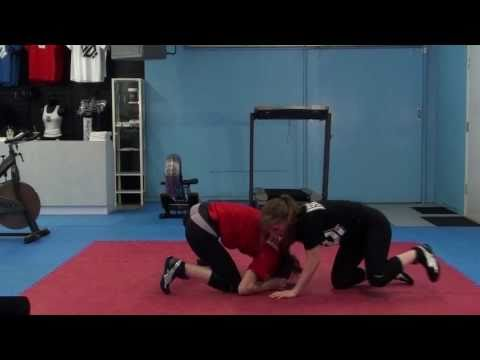 Front Headlock Technique - Beginner Women's MMA Wrestling Moves Image 1