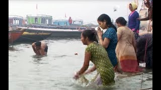 Download People bathing in the Ganges river HD stock video footage 3Gp Mp4