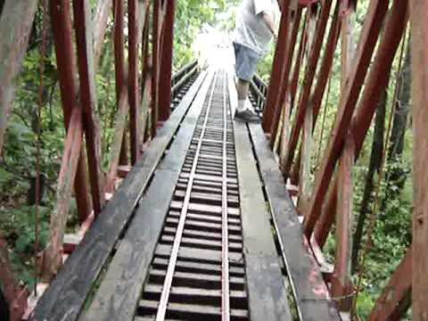 walking across a 130 foot train bridge 14 feet off the ground.