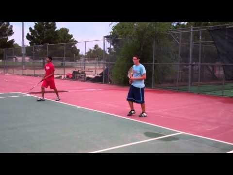 Boys tennis team returning ball at Summer Tennis Program at Socorro High School, El Paso TX.