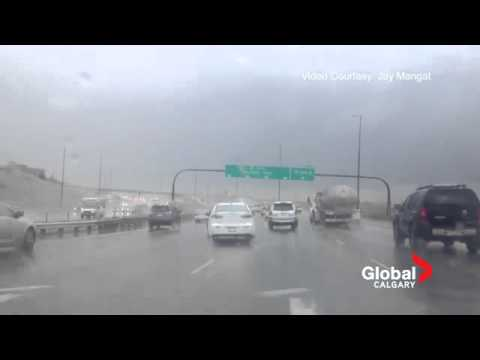INCREDIBLE FOOTAGE Sign blowing around on Deerfoot