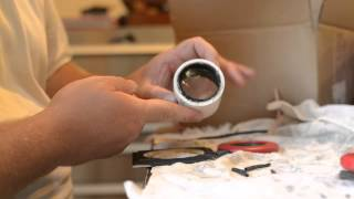 building a large format lens with magnifying glass and spaghetti measure
