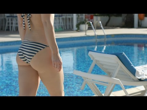 Hot female in bikini walking near pool. Sexy bottom, fit body. Stock Footage