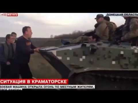 Man tries to stop Russian military tank with bare hands as Ukraine's pro-Russian militants hold firm