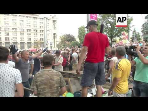 Activists clash with city workers as they dismantle barricades in Independence Square