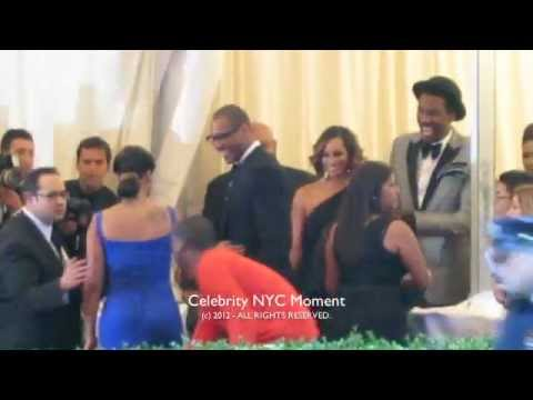 Carmelo Anthony and Amare Stoudemire greet each other while Lala Vasquez pose at the MET gala in NYC