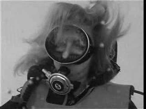 Susi diving in vintage scuba gear Video