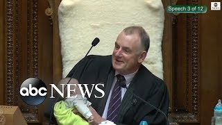 New Zealand parliament speaker cradles politician's baby during debate