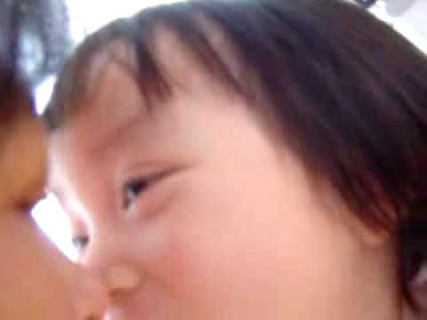 Young asian girls are kissing.............
