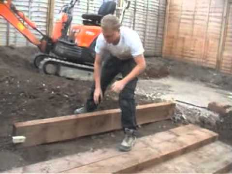 how to build a retaining wall out if sleepers