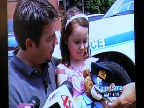 Emma Flynn donates piggy bank money to fallen officers memorial fund