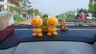 WhatsApp emoji dolls in my car