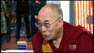 The Dalai Lama walks into a pizza shop