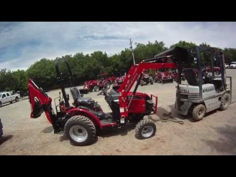 Mahindra Max 25 lifts the back of a forklift!