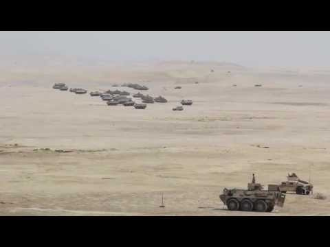 U.S. Marines And Qatar Emiri Land Forces Conduct Parachute And Mechanized Infantry Assault
