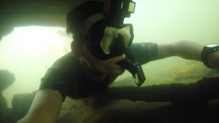 Catching Catfish Underwater with Bare Hands! (Noodling)