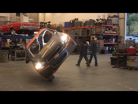 Incredible Stunt Driving...Car Drives on Two Wheels Thru a Shop !