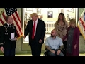 President Trump presents Purple Heart to US service member mp3 indir