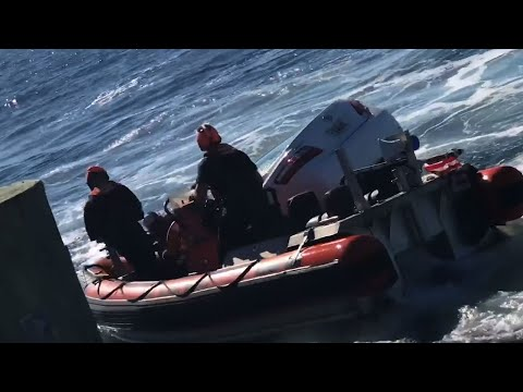 Raw: US Coast Guard Rescues Man From Sinking Car