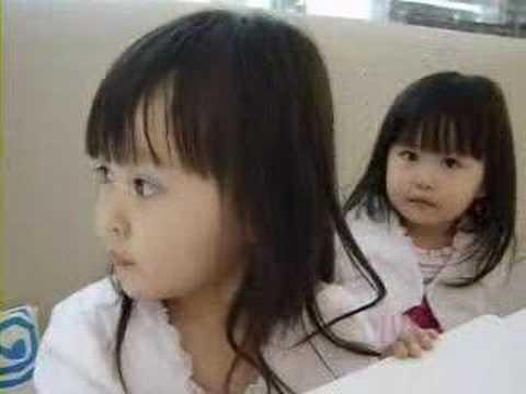 Two beautiful Chinese girls kissing