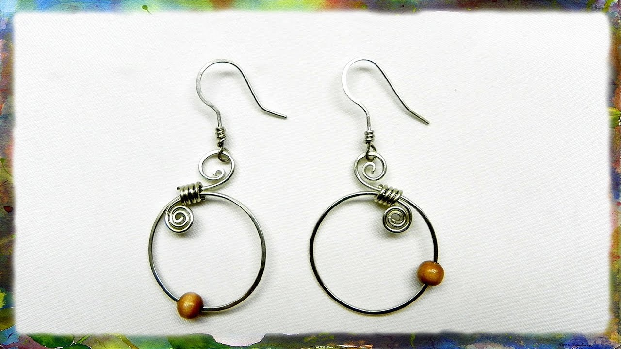 How to make silver wire spiral earrings with blue beads for Step by step wire jewelry subscription