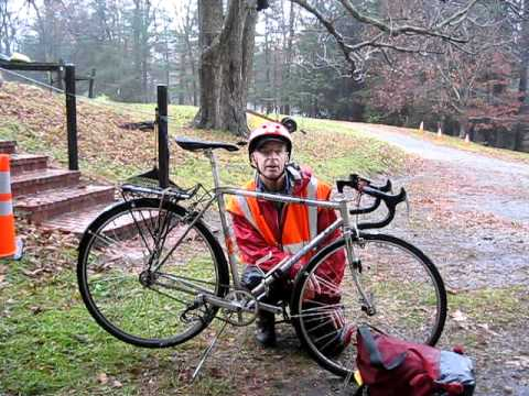 Riding a bicycle in the rain.AVI