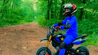 Den on Pocket bike in forest